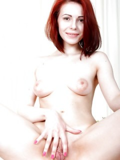 Hot Redhead Spreads Her Shaved Pussy Lips Wide Open
