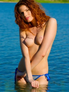 Redhead Sara Stripping By The Lake